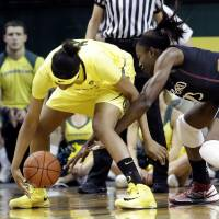Photo - Stanford forward Chiney Ogwumike, right, battles for a loose ball with Oregon forward Jillian Alleyne during the first half of an NCAA college basketball game in Eugene, Ore., Friday, Feb. 1, 2013. (AP Photo/Don Ryan)