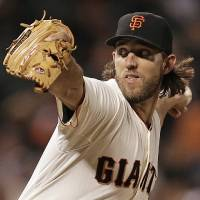 Photo - San Francisco Giants' Madison Bumgarner works against the Colorado Rockies in the seventh inning of a baseball game Tuesday, Aug. 26, 2014, in San Francisco. (AP Photo/Ben Margot)