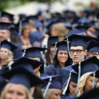 Photo - Nate Bauer, of Guymon, a Psychology major, waits with his peers before walking during a University of Central Oklahoma graduation ceremony in Edmond, Friday, May 4.  Photo by Garett Fisbeck, For The Oklahoman
