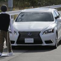 Photo -   Toyota's Lexus LS stops automatically in front of a dummy during a Toyota Motor Corp. demonstration of the pre-collision system (PCS) at its Higashi-Fuji Technical Center in Susono, southwest of Tokyo, Monday, Nov. 12, 2012. The PCS, one of the automaker's pedestrian accident countermeasures, watches out for pedestrians to avoid collisions with them. (AP Photo/Koji Sasahara)