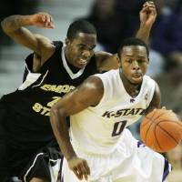 Photo - Kansas State guard Jacob Pullen (0) gets away from Emporia State guard Lamar Wilbern (24) during the first half of an NCAA college men's basketball game in Manhattan, Kan., Wednesday, Nov. 19, 2008. (AP Photo/Orlin Wagner) ORG XMIT: KSOW102