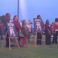 Photo - Selmon family members stand on the field at Eufaula during a ceremony retiring the numbers of Lee Roy, Dewey and Lucious Selmon on Friday, Sept. 28, 2012. PHOTO BY RYAN ABER, THE OKLAHOMAN