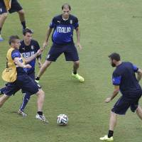 Photo - Italy's Ciro Immobile, left, and Matteo Darmian, second from left, vie for control of the ball, as Gabriel Paletta, top, and Andrea Barzagli watch during a training session, a the day before their group D World Cup soccer match, at the Arena das Dunas in Natal, Brazil, Monday, June 23, 2014. (AP Photo/Antonio Clanni)