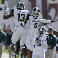 Photo -   Michigan State wide receiver Bennie Fowler (13) celebrates with cornerback Johnny Adams (5) after Fowler scored on a 36-yard touchdown reception during the second half of an NCAA college football game against Indiana Saturday, Oct. 6, 2012, in Bloomington, Ind. Michigan State defeated Indiana 31-27. (AP Photo/Darron Cummings)