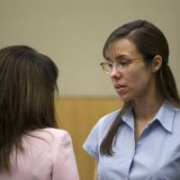 Photo - Jodi Arias, right, talks to her attorney, Jennifer Wilmott during her trial at Maricopa County Superior Court in Phoenix   on Wednesday, April 10, 2013.  Arias is on trial for the killing  Travis Alexander, in 2008.   (AP Photo/The Arizona Republic, David Wallace, Pool)
