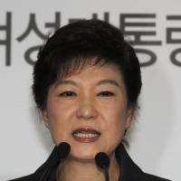 Photo - South Korea's president-elected Park Geun-hye speaks during a press conference at the headquarters of Saenuri Party in Seoul, South Korea, Thursday, Dec. 20, 2012. Park was elected South Korean president Wednesday, becoming the country's first female leader despite the incumbent's unpopularity and her own past as the daughter of a divisive dictator. The letters read