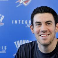 Photo - OKLAHOMA CITY THUNDER NBA BASKETBALL TEAM: Oklahoma City's Nick Collison (4) speaks during a press conference at the Integris Health Thunder Development Center in Oklahoma City,  Saturday, June 23, 2012. Photo by Sarah Phipps, The Oklahoman