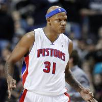 Photo - Detroit Pistons forward Charlie Villanueva reacts after sinking one of his three 3-point baskets against the Miami Heat in the first half of an NBA basketball game Friday, Dec. 28, 2012, in Auburn Hills, Mich. (AP Photo/Duane Burleson)