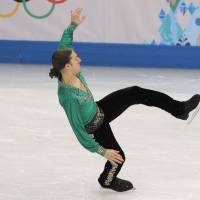 Photo - Jason Brown of the United States loses his balance as he competes in the men's free skate figure skating final at the Iceberg Skating Palace during the 2014 Winter Olympics, Friday, Feb. 14, 2014, in Sochi, Russia. (AP Photo/Vadim Ghirda)