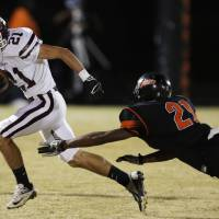 Photo - Ada's Chase Lott (21) runs past Douglass's Barry Knight (21) during a high school football game between Douglass and Ada at Moses F. Miller Stadium in Oklahoma City, Friday, Nov. 2, 2012.  Photo by Garett Fisbeck, The Oklahoman
