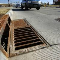 Photo - A newly installed storm drain is shown on SE 15 in Del City. The city recently completed a major road improvement project on SE 15 extending west from Sooner Road. Photo by Jim Beckel, The Oklahoman