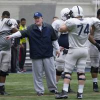 "Photo - FILE - In this April 5, 2014, file photo, Penn State offensive line coach Herb Hand motions to players during a team practice in State College, Pa. Hand, who took to Twitter recently to vent his frustration with a recruit gone bad online. ""Dropped another prospect this AM due to his social media presence ... Actually glad I got to see the 'real' person before we offered him,"" Hand tweeted. (AP Photo/PennLive.com. Joe Hermitt, File)"