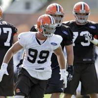 Photo - Cleveland Browns linebacker Paul Kruger (99) chases a play during drills at the NFL football team's facility in Berea, Ohio, Friday, July 26, 2013. (AP Photo/Mark Duncan)