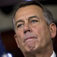 Photo - Speaker of the House John Boehner, R-Ohio, speaks to reporters about the fiscal cliff negotiations at the Capitol in Washington, Friday, Dec. 21, 2012. Hopes for avoiding the