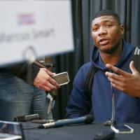 Photo -  Marcus Smart from Oklahoma State talks to reporters at the 2014 NBA basketball Draft Combine Thursday, May 15, 2014, in Chicago. Smart did not participate in his scheduled workout Thursday. (AP Photo/Charles Rex Arbogast)