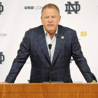 Photo - FILE - In this Aug. 1, 2014, file photo, Notre Dame football coach Brian Kelly talks to the media at the beginning of fall practice in South Bend, Ind. Notre Dame says it is investigating