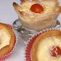 Photo - Using a pre-made bread dough, such as crescent roll dough, makes egg tarts an easier dish to make. (Joan Barnett Lee/Modesto Bee/MCT)
