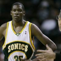 Photo - ** ADVANCE FOR WEEKEND EDITIONS, OCT. 27-28 **  Seattle SuperSonics head coach P.J. Carlemiso, right, talks to rookie Kevin Durant during a time-out in an NBA exhibition basketball game Saturday, Oct. 20, 2007 at KeyArena in Seattle. Newly hired by the Sonics, Carlesimo is back as a head coach, his task now being the development of Durant and trying to revitalize a once-proud franchise rife with questions about its off-court future. (AP Photo/Ted S. Warren) ORG XMIT: WATW302