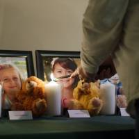 Photo - A candle is lit in memory of Madeleine Hsu during a vigil in Pearland, Texas Friday, Dec. 21, 2012.   (AP Photo/The Courier, Kirk Sides) ORG XMIT: NY926