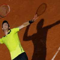 Photo - Britain's Andy Murray serves to Germany's Philipp Kohlschreiber during their third round match of  the French Open tennis tournament at the Roland Garros stadium, in Paris, France, Saturday, May 31, 2014. (AP Photo/David Vincent)