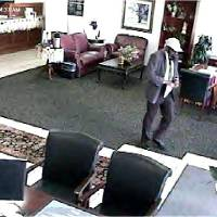 Photo -  A black male leaves the First Fidelity Bank, 10904 N May Ave. in northwest Oklahoma City, after robbing it about 9:45 a.m. Wednesday. Photo provided