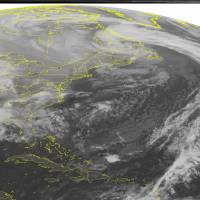 Photo - This NOAA satellite image taken Monday, Dec. 24, 2012 at 01:45 AM EST shows a low pressure system over eastern Canada with a cold front stretching across the central Atlantic Ocean. A low pressure system is moving across the Mississippi Valley into the southeastern United States with areas of rain and scattered thunderstorms. Father north, snow showers are seen over the Mid-West. (AP PHOTO/WEATHER UNDERGROUND)