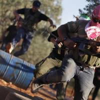 Photo -   Free Syrian Army members train with their weapons on the outskirts of Idlib, Syria, Thursday, June 7, 2012. (AP Photo)