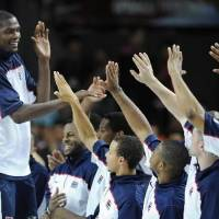 Photo - Tournament MVP USA's Kevin Durant, left, celebrates with teammates after the final of the World Basketball Championship between Turkey and the USA, Sunday, Sept. 12, 2010, in Istanbul. USA won 81-64. (AP Photo/Mark J. Terrill)