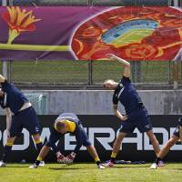 Photo -   Sweden's players stretch during a training session on the Koncha Zaspa Training Centre near of Kiev, Ukraine, Friday, June 8, 2012.The Sweden team will be based in the capital of Ukraine for the Euro 2012 soccer championships. (AP Photo/Sergei Grits)