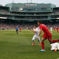 Photo - Liverpool FC defender Jose Enrique (3) chases the ball against AS Roma during a friendly soccer match at Fenway Park in Boston, Wednesday, July 23, 2014. (AP Photo)