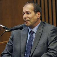 Photo - Theodore Wafer testifies in his own defense during the seventh day of testimony for the Nov. 2, 2013, killing of Renisha McBride, Monday, Aug. 4, 2014, in Detroit. He said he feared for his life when he fired at McBride on his porch in Dearborn Heights, Mich. Wafer is charged with second-degree murder and could be sentenced to up to life in prison with the chance for parole, if he's convicted. (AP Photo/Detroit News, Clarence Tabb Jr.)
