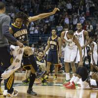 Photo - Indiana Pacers' Chris Copeland (22) reacts after sinking a game-winning shot against the Milwaukee Bucks during the second half of an NBA basketball game on Wednesday, April 9, 2014, in Milwaukee. The Pacers defeated the Bucks 104-102. (AP Photo/Tom Lynn)