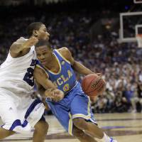 Photo - ** ADVANCE FOR WEEKEND EDITIONS JUNE 21-22 -- FILE -- **      UNIVERSITY OF CALIFORNIA, LOS ANGELES: In this April 5, 2008 file photo, UCLA's Russell Westbrook, right, drives past Memphis' Antonio Anderson (5) during a semifinals game at the college basketball Final Four in San Antonio. Westbrook is a potential first round draft pick in the NBA Draft, which takes place June 26 in New York. (AP Photo/Eric Gay, File) ORG XMIT: NY282