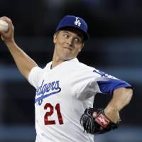 Photo - Los Angeles Dodgers starter Zack Greinke pitches to the Pittsburgh Pirates in the first inning of a baseball game in Los Angeles, Friday, April 5, 2013. (AP Photo/Reed Saxon)