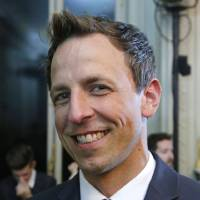 Photo - American talk show host Seth Meyers poses for photographers prior to Valentino men's Spring-Summer 2015 fashion collection presented in Paris, Wednesday, June 25, 2014. (AP Photo/Michel Euler)