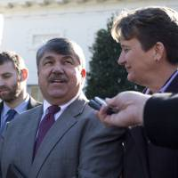 Photo -   AFL-CIO President Richard Trumka, center, accompanied by Justin Ruben, executive director of MoveOn.org, left, and Mary Kay Henry, International President of the Service Employees International Union, speaks to reporters outside the White House in Washington, Tuesday, Nov. 13, 2012, after a meeting between business leaders and President Barack Obama to discuss the economy and deficit. (AP Photo/Carolyn Kaster)