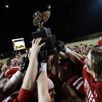 Photo - Davis celebrates their win over Millwood in the Class 2A state football championship game  at Moore High School in Moore, Okla.,  Thursday, Dec. 19, 2013. Photo by Sarah Phipps, The Oklahoman