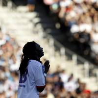 Photo -   Lyon's Bafe Gomis reacts during their French League One soccer match against Ajaccio at Gerland stadium, in Lyon, central France, Sunday, Sept. 16, 2012. (AP Photo/Laurent Cipriani)