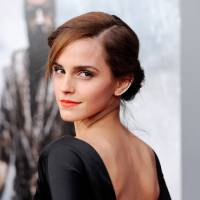 Photo - FILE - This March 26, 2014 file photo shows actress Emma Watson at the premiere of