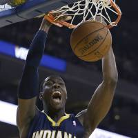 Photo - Indiana Pacers' Ian Mahinmi scores against the Golden State Warriors during the first half of an NBA basketball game, Monday, Jan. 20, 2014, in Oakland, Calif. (AP Photo/Ben Margot)