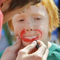 Photo - Elias Gates, 7, gets his face painted at the Center for Children and Families' annual I Love My Neighborhood block party at Trinity Baptist Church on Saturday, April 9, 2011, in Norman, Okla.   Photo by Steve Sisney, The Oklahoman