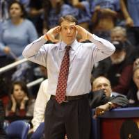 Photo - University of Massachusetts coach Travis Ford gestures during the first half of a college basketball game against Rhode Island Thursday, Feb. 21, 2008, in South Kingstown, R.I.  Massachusetts won, 98-91. (AP Photo/Stew Milne) ORG XMIT: RISM107
