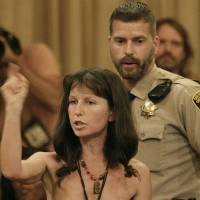 Photo -   Protester Gypsy Taub speaks out against the Board of Supervisors decision to ban public nakedness while naked at City Hall in San Francisco, Tuesday, Nov. 20, 2012. San Francisco lawmakers on Tuesday narrowly approved a proposal to ban public nakedness, rejecting arguments that the measure would eat away at a reputation for tolerance enjoyed by a city known for flouting convention and flaunting its counter-culture image. The 6-5 Board of Supervisors vote means that exposed genitals will be prohibited in most public places, including streets, sidewalks and public transit. (AP Photo/Jeff Chiu)