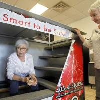Photo - Sandra Blackstock, right, helps Elizabeth Prosser of Oklahoma City shop for a storm shelter at Smart Shelters in Oklahoma City.  Aliki Dyer - The Oklahoman