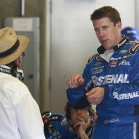 Photo - Driver Carl Edwards talks with owner Jack Roush during practice for the Brickyard 400 Sprint Cup series auto race at the Indianapolis Motor Speedway in Indianapolis, Friday, July 25, 2014. (AP Photo/R Brent Smith)