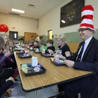 Photo - Edmond Public Schools Superintendent David Goin eats green eggs and ham with first-graders at Clegern Elementary School in honor of Dr. Seuss' birthday. PHOTO BY PAUL HELLSTERN, THE OKLAHOMAN.  PAUL HELLSTERN - Oklahoman