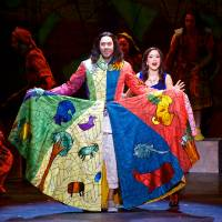"""Photo -  Joseph, portrayed by Ace Young, shows off his character's famous coat of many colors as The Narrator (Diana DeGarmo) looks on in a performance of """"Joseph and the Amazing Technicolor Dreamcoat."""" PHOTO PROVIDED   Daniel A Swalec"""