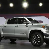Photo - The redesigned 2014 Toyota Tundra is eunveiled at the Chicago Auto Show Thursday, Feb. 7, 2013, in Chicago. (AP Photo/Charles Rex Arbogast)
