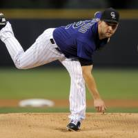 Photo -   Colorado Rockies pitcher Tyler Chatwood throws against the Arizona Diamondbacks during the first inning of a baseball game, Monday, Sept. 24, 2012, in Denver. (AP Photo/Jack Dempsey)