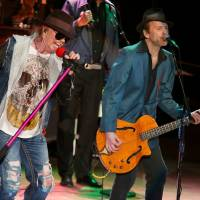 Photo - Axl Rose and Tommy Stinson of Guns N' Roses  perform at the Bridge School Benefit Concert at the Shoreline Amphitheatre on Saturday, Oct. 20, 2012, in Mountain View, Calif. (Photo by Barry Brecheisen/Invision/AP) ORG XMIT: NYET411